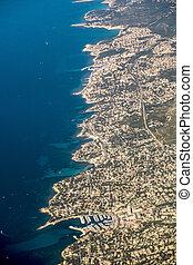 aerial of industrial area near the ocean