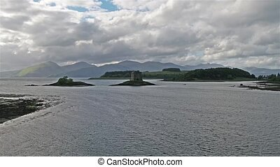 Aerial of Loch Laich and the historic castle Stalker in...