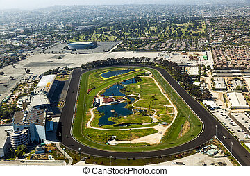 aerial of Los Angeles and the Hollywood Park with horse race track