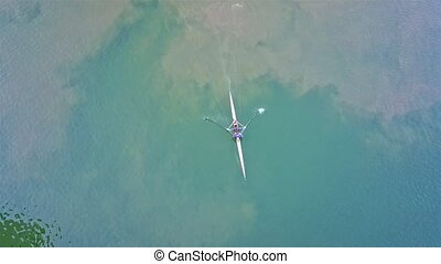 Aerial of man canoeing on the river Rhine, Krefeld, Germany