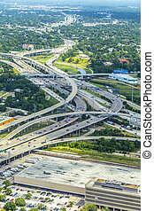 aerial of modern highway, bridges, infrastructure and streets in  Houston