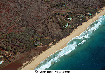 Aerial of Northwest coast of Molokai with waves crashing into Beach