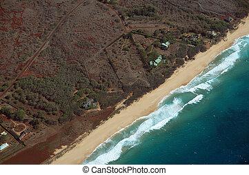 Aerial of Northwest coast of Molokai with waves crashing into Beach