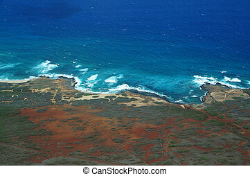 Aerial of Northwest coast of Molokai with waves crashing into shore