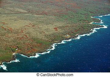 Aerial of Northwest coast of Molokai with waves crashing into shore