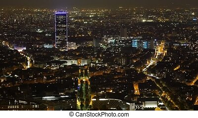 Aerial of Paris at night with a skyscrapper in the background in autumn