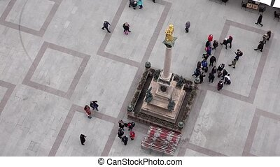 Aerial of people walking on square - time lapse
