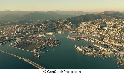 Aerial of seaport and cityscape of Genoa in the evening. Italy