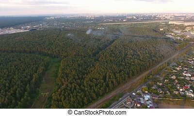 Aerial of shot of Kiev suburbs with a highway going through...