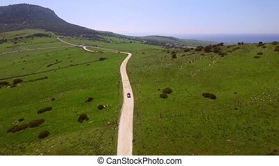 Aerial Of The Hilly Road With Driving Lonely Car