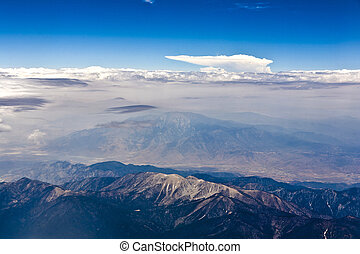 aerial of the mountains of Nevada and scenic clouds by approaching Los Angeles