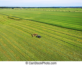Aerial of tractor in the field