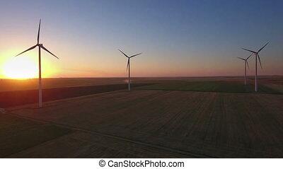Aerial of wind turbines in field