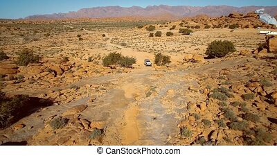 Aerial, Offroad Fun At The Blue Painted Rocks, Valle de Tafraute, Morocco