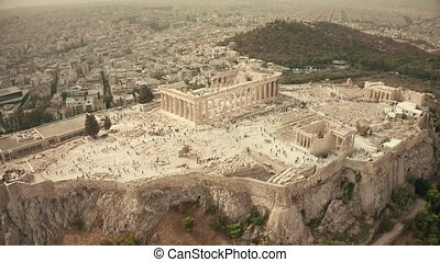Aerial orbiting shot of the famous Parthenon temple and Acropolis