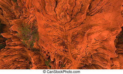 AERIAL. Overhead drone shot of Red Canyon rocks in Mui Ne, Vietnam. Abstract orange background for text or title