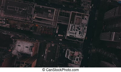 AERIAL: Overhead View of Skyscraper Building Rooftops in Manhattan New York City at Dawn after Sunset