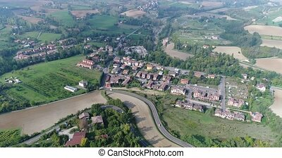 Aerial overhead view of the vineyards of Italy, small medieval town of Italy, Panoramic view from above of the vineyards of Italy