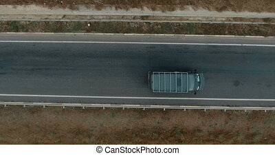 Aerial overlooking the highway with cars, trucks and other transport.