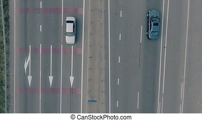 Aerial overlooking the hiway with cars, trucks and other transport.
