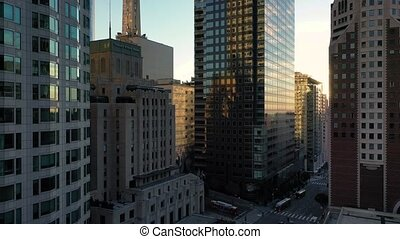 Aerial pan between downtown Los Angeles LA street, California Plaza, Financial District at sunrise