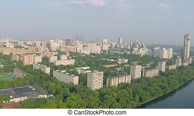 Aerial pan shot of Moscow and Moscow river, western wealthy...