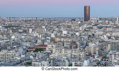 Aerial panorama above houses rooftops in a Paris day to...