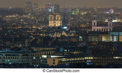 Aerial panorama above houses rooftops in a Paris night...
