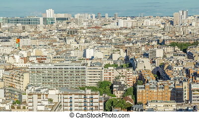 Aerial panorama above houses rooftops in a Paris timelapse....