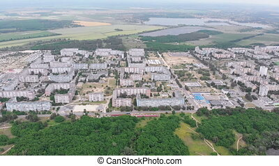 Aerial Panorama on Dwelling Blocks with Multistory Colorful Buildings near Nature and River. USSR apartments in housing condominiums for families. Panorama to rooftops and facades. Fly over small town