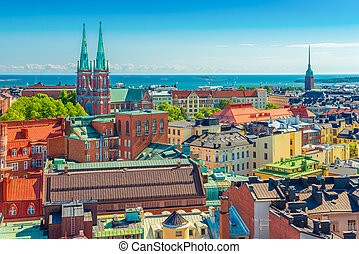 Aerial panorama of Helsinki. Cityscape of the Capital of Finland with Baltic Sea in the background. Colorful houses in the traditional Scandinavian architecture style