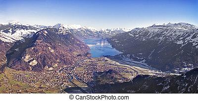Aerial panorama of city of Interlaken and Brienz lake