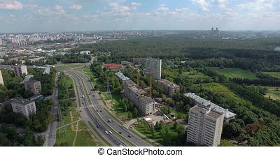 Aerial panorama of Moscow buildings and vast greenspace, ...