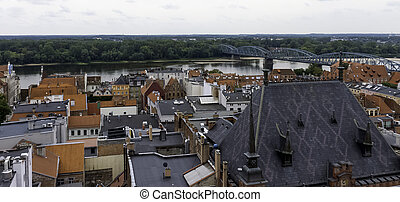 Aerial panorama of Old Town with bridge over Vistula River in background - Torun, Poland