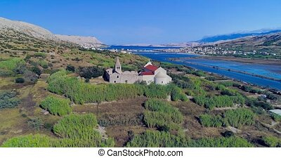 Aerial panorama of The Old Town of Pag and the remains of a ...