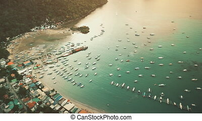 Aerial panorama of tropic port city with boats, ships at ...