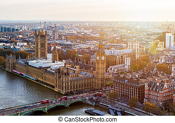 Aerial panorama view on London. View towards Houses of Parliament, London Eye and Westminster Bridge on Thames River.
