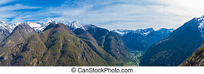 aerial panorama view on upper Maggia valley with snowcapped mountains and blue sky