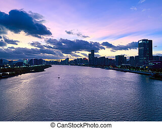 Aerial panoramic cityscape view of Fuzhou and the River Min at sunset, Fujian, China