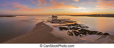 Aerial panoramic dusk and historic life-guard building at...