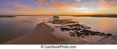 Aerial panoramic dusk and historic life-guard building at...