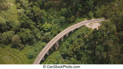 Aerial panoramic top view, drone turning left over Nine Arch Bridge Ella in Sri Lanka among exotic lush green trees.