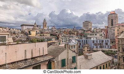 Aerial panoramic view of european city Genoa (Genova) timelapse from above of old historical centre quarter districts, panorama, Liguria, Italy. Old houses and cloudy sky