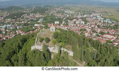 Aerial panoramic view of small picturesque town Sinj,...