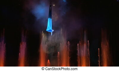 Aerial performance on the stage with fountains