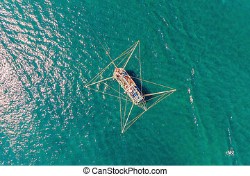 Aerial photo of a big fisherman boat in an open sea