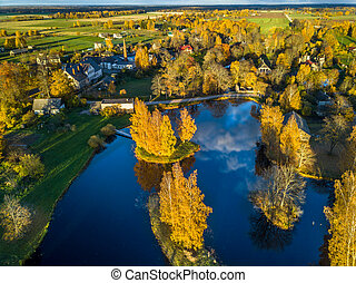 Aerial Photo of a Lake in Sunny Autumn Day