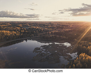 Aerial Photo of a Sunset over Forest in Autumn Day - vintage look edit