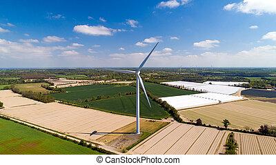 Aerial photo of a wind turbine in a field