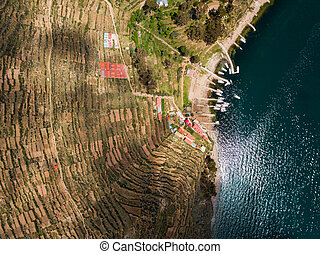 Aerial photo of boats at lake Titicaca